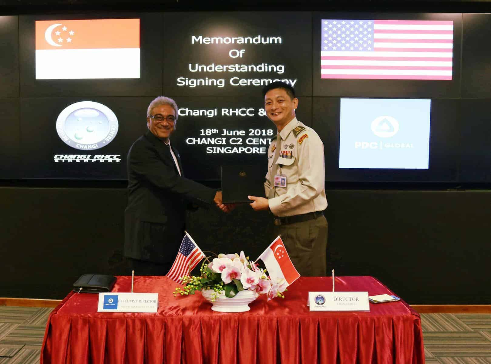 PDC Executive Director Ray Shirkhodai and RHCC Director COL Lee Kuan Chung shake hands during MOU signing ceremony.
