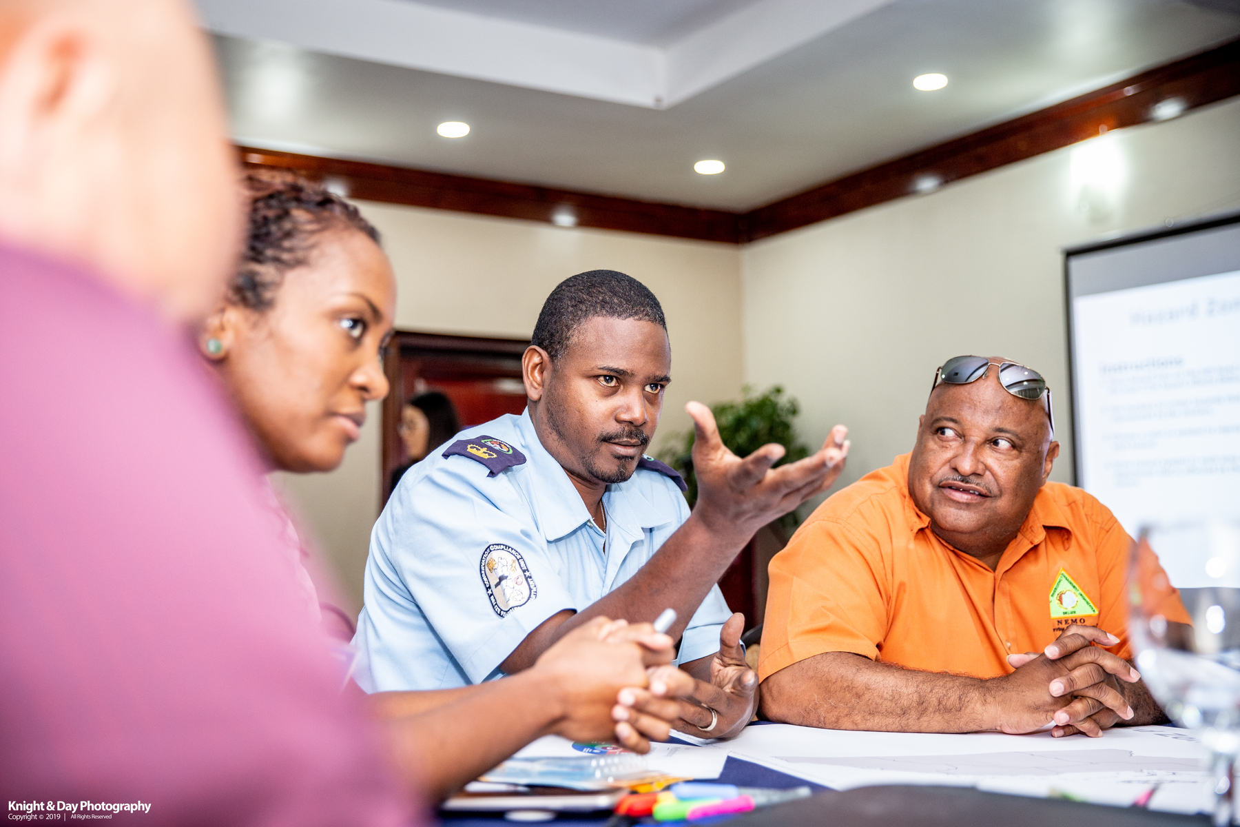 Belize disaster management professionals discuss a mapping exercise at the NDPBA kick off